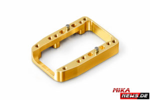 Xray_v_338721 NT1 2016 Brass 1-Piece Engine Mount